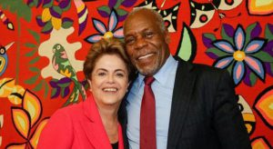 Dilma, dura de matar: con Danny Glover, sollidario